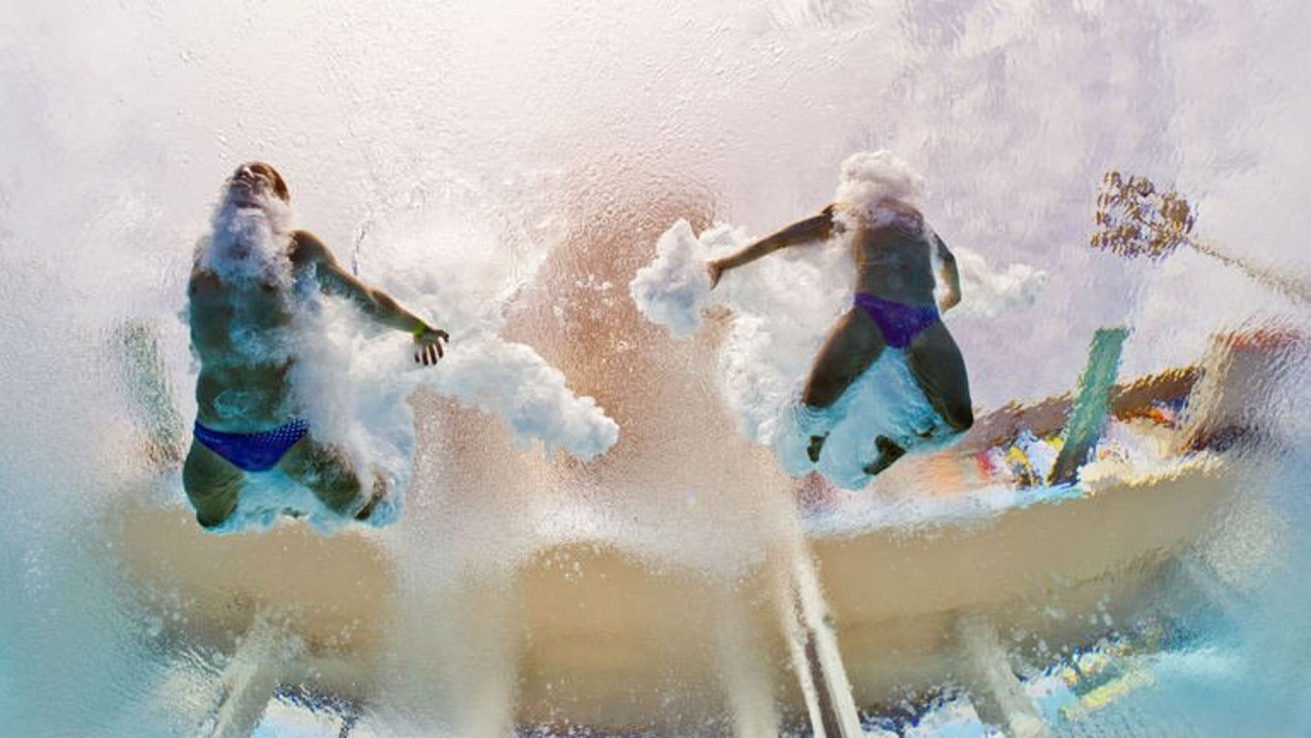 In a picture taken with an underwater camera Germany's Sascha Klein and Patrick Hausding compete in the men's 10-metre synchro platform preliminary diving event in the FINA World Championships at the Piscina Municipal de Montjuic in Barcelona on July 21, 2013.