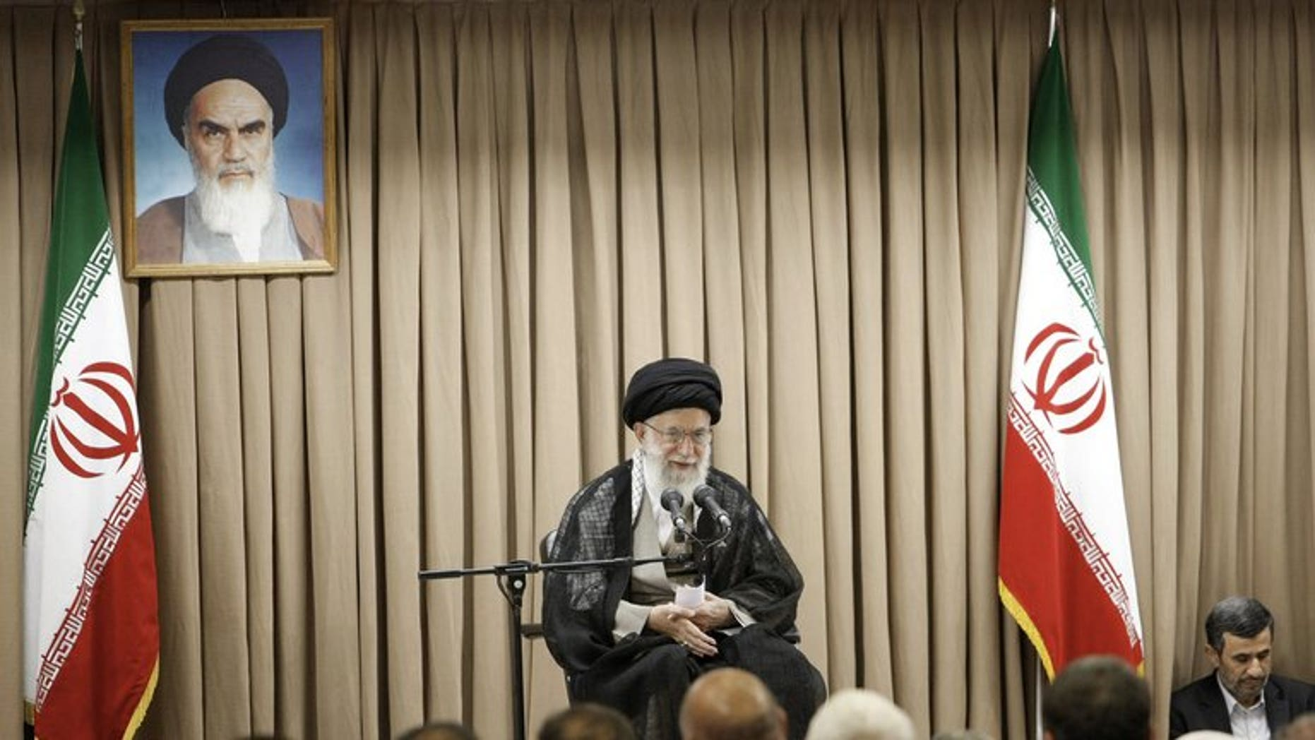 "A picture released by the website of Iranian supreme leader Ayatollah Ali Khamenei (C) shows him speaking at a meeting with Iranian officials in the presence of outgoing President Mahmoud Ahmadinejad (R) in Tehran on July 21, 2013. Khamenei warned that Washington was ""not trustworthy"", after former US officials and lawmakers urged diplomacy with the Islamic republic's incoming president."