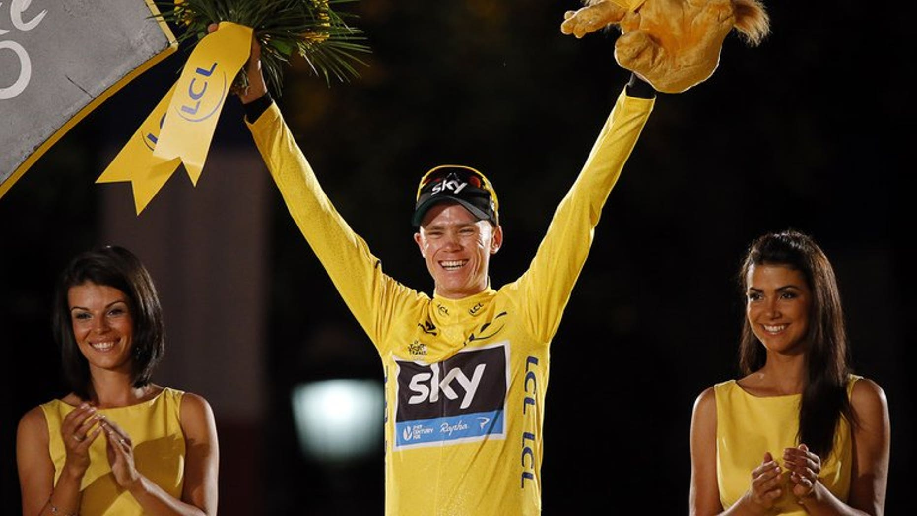 Tour de France 2013 winner Britain's Chris Froome poses on the podium in Paris on the Champs-Elysee avenue, at the end of the 133.5 km twenty-first and last stage of the 100th edition of the Tour de France cycling race on July 21, 2013 between Versailles and Paris.