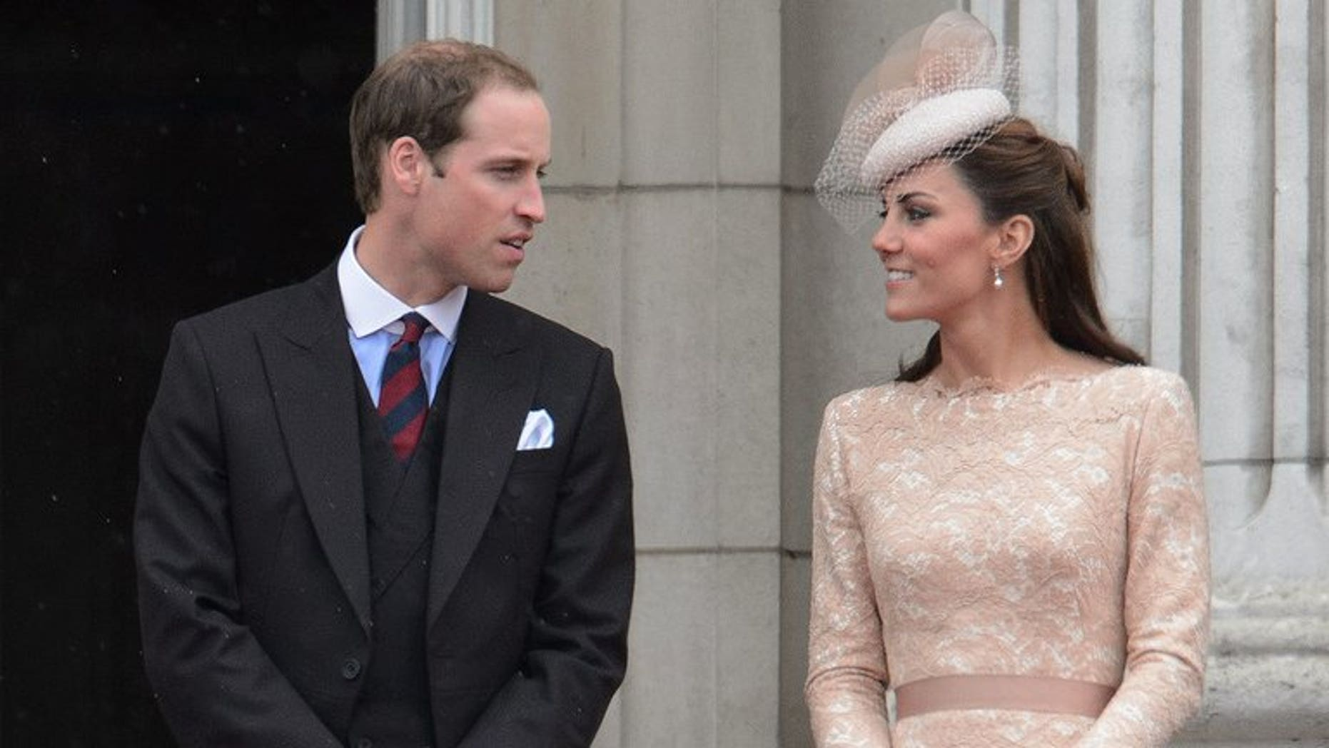 Prince William (L) and his wife Catherine, seen on the balcony of Buckingham Palace on June 5, 2012.