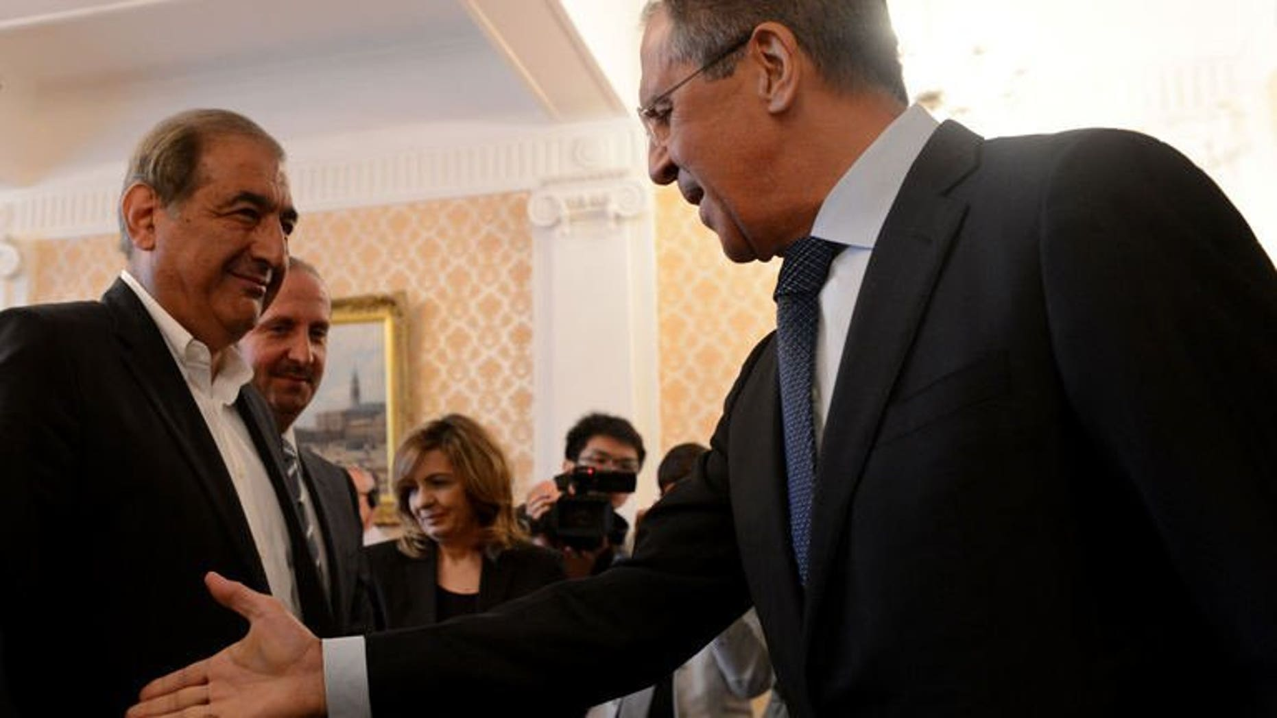 Russian Foreign Minister Sergei Lavrov (R) speaks with Syrian deputy Prime Minister Qadri Jamil during their meeting in Moscow on July 22, 2013. Russia is pressing on with efforts to hold a peace conference in Geneva to end the bloodshed in Syria as soon as possible but the opposition is so far not showing readiness to take part, Lavrov said Monday.