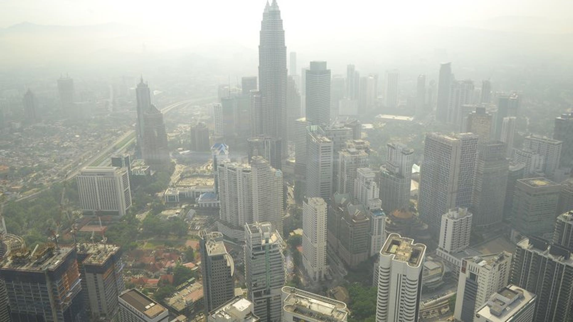 The Kuala Lumpur skyline is seen covered by haze, on June 27, 2013. Haze has blanketed parts of Malaysia, weeks after the region suffered its worst pollution from forest fires in Indonesia in more than a decade.