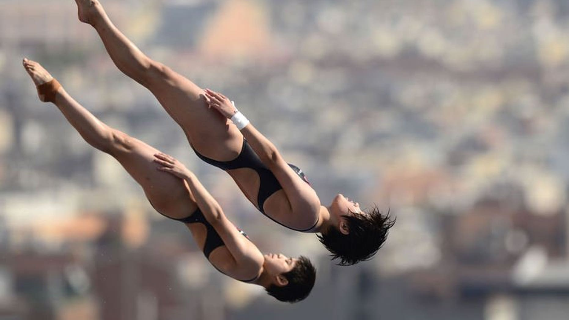 China's Liu Huixia and Chen Ruolin compete in the women's 10-metre synchro platform preliminary diving event in the FINA World Championships at the Piscina Municipal de Montjuic in Barcelona on July 22, 2013. The pair eased to victory in Monday's world championship final of the women's 10m synchronised platform in Barcelona.