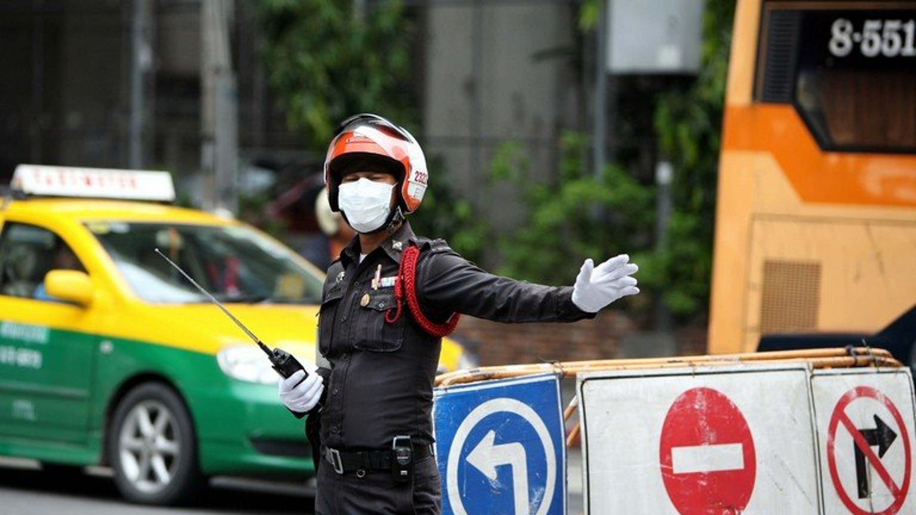 Illustration of a Thai traffic police officer. Nineteen people were killed and 20 hurt Tuesday when a double decker coach collided with a truck in central Thailand and burst into flames, authorities said.
