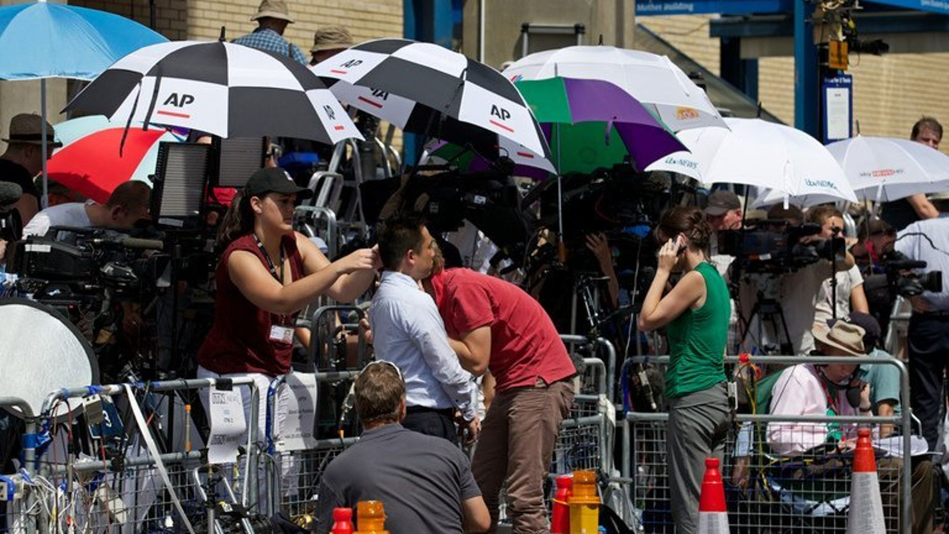 "Media gather outside St Mary's hospital, on July 22, 2013. The Sun on Tuesday changed its name to ""The Son"" to honour the arrival of a baby boy for Prince William and Kate"