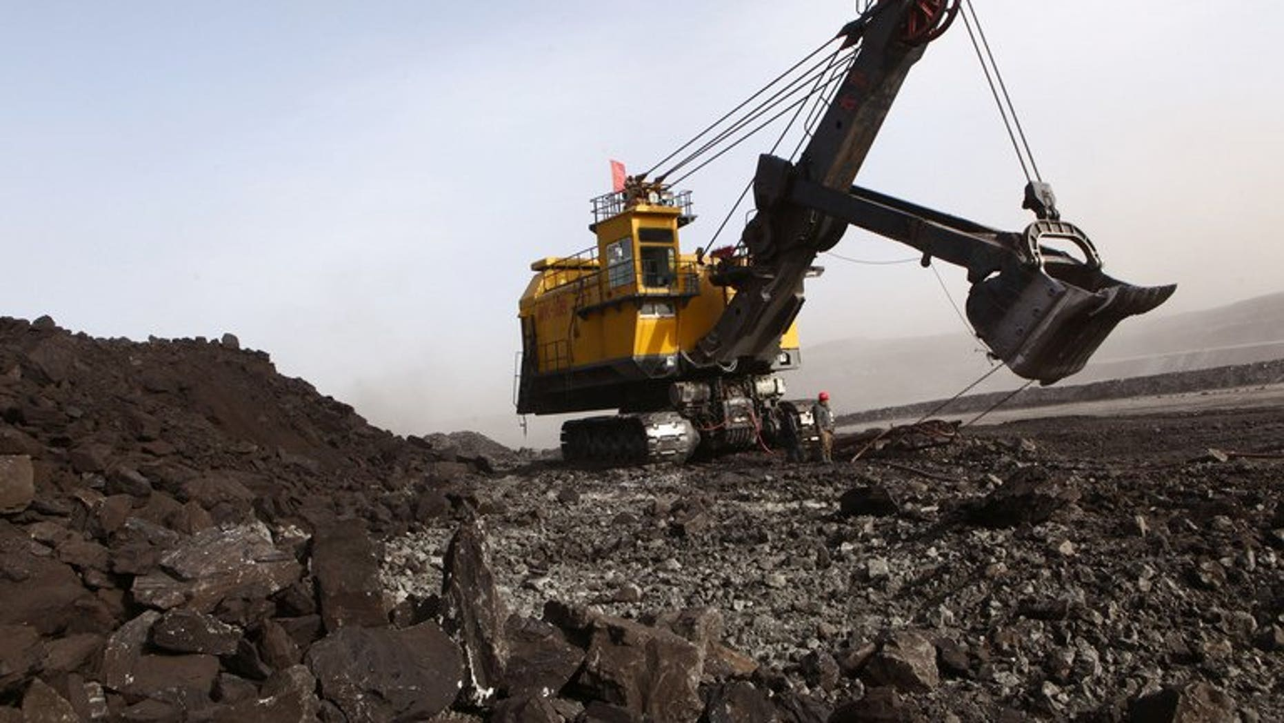 """This file photo shows a coal mine in Huo Lin Guo Le, China's north Inner Mongolia region, on November 15, 2010. A major state-owned coal producer has caused """"drastic drops"""" in groundwater near one of its projects in the region, the environmental group Greenpeace said in a report."""