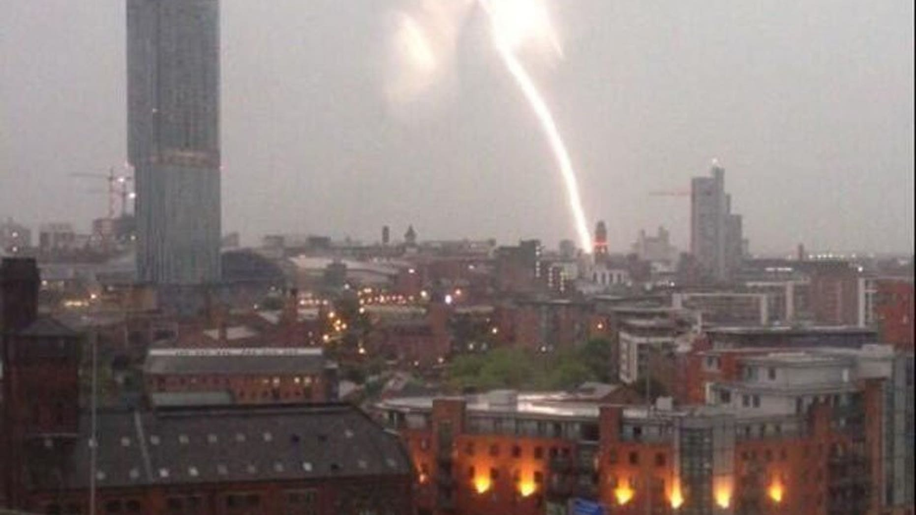 A screen grab from a video taken early on July 23, 2013 shows a lightning strike near Manchester Piccadilly train station in Manchester, north-west England. Lightning strikes and flooding caused severe delays for commuters on several mainline rail services across England and Scotland early on Tuesday.