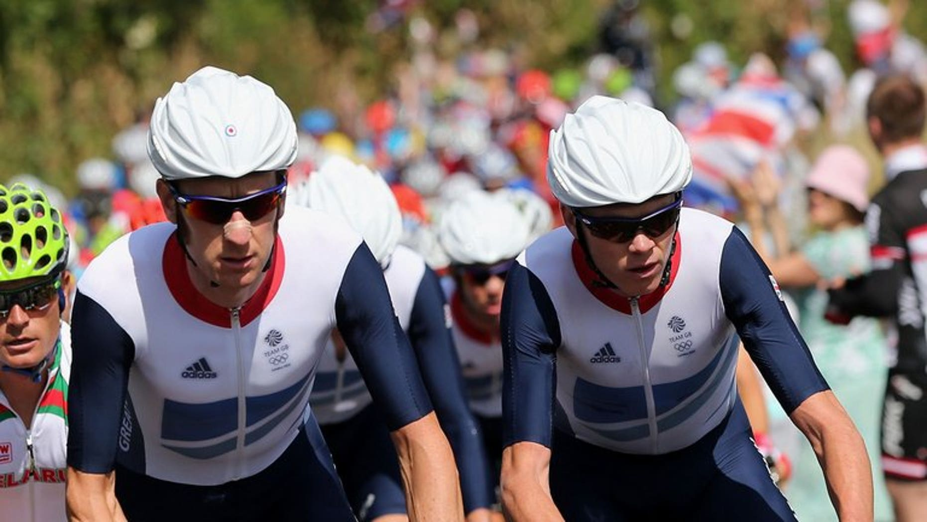 Bradley Wiggins (L) rides next to Chris Froome (R) in the London 2012 Olympic Games on July 28, 2012. Team Sky boss Dave Brailsford would love to see Froome and Wiggins, the last two Tour de France winners, lining up together when the race heads to Britain next year.