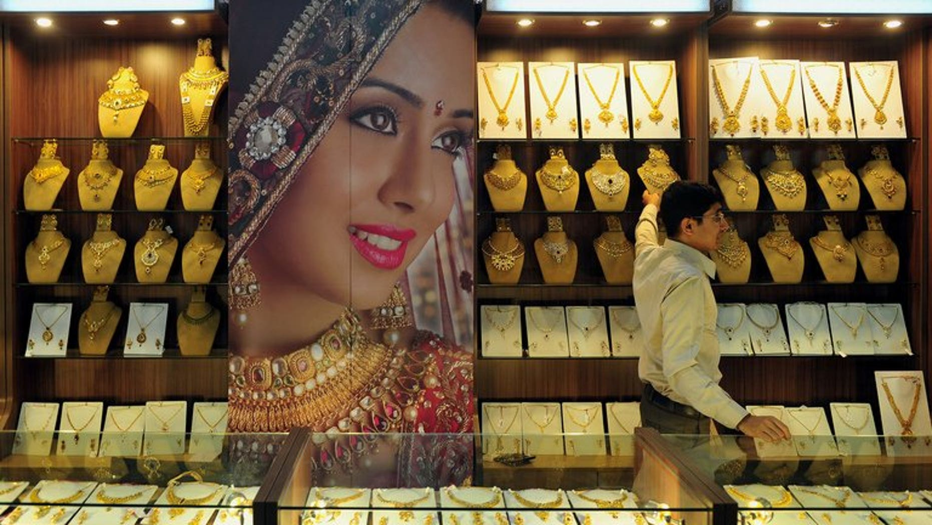 An Indian jewellery store worker pictured in Bangalore on October 14, 2011. India, the world's biggest gold-buying nation, has slapped fresh curbs on imports of the precious metal in a bid to curb a record current account deficit.