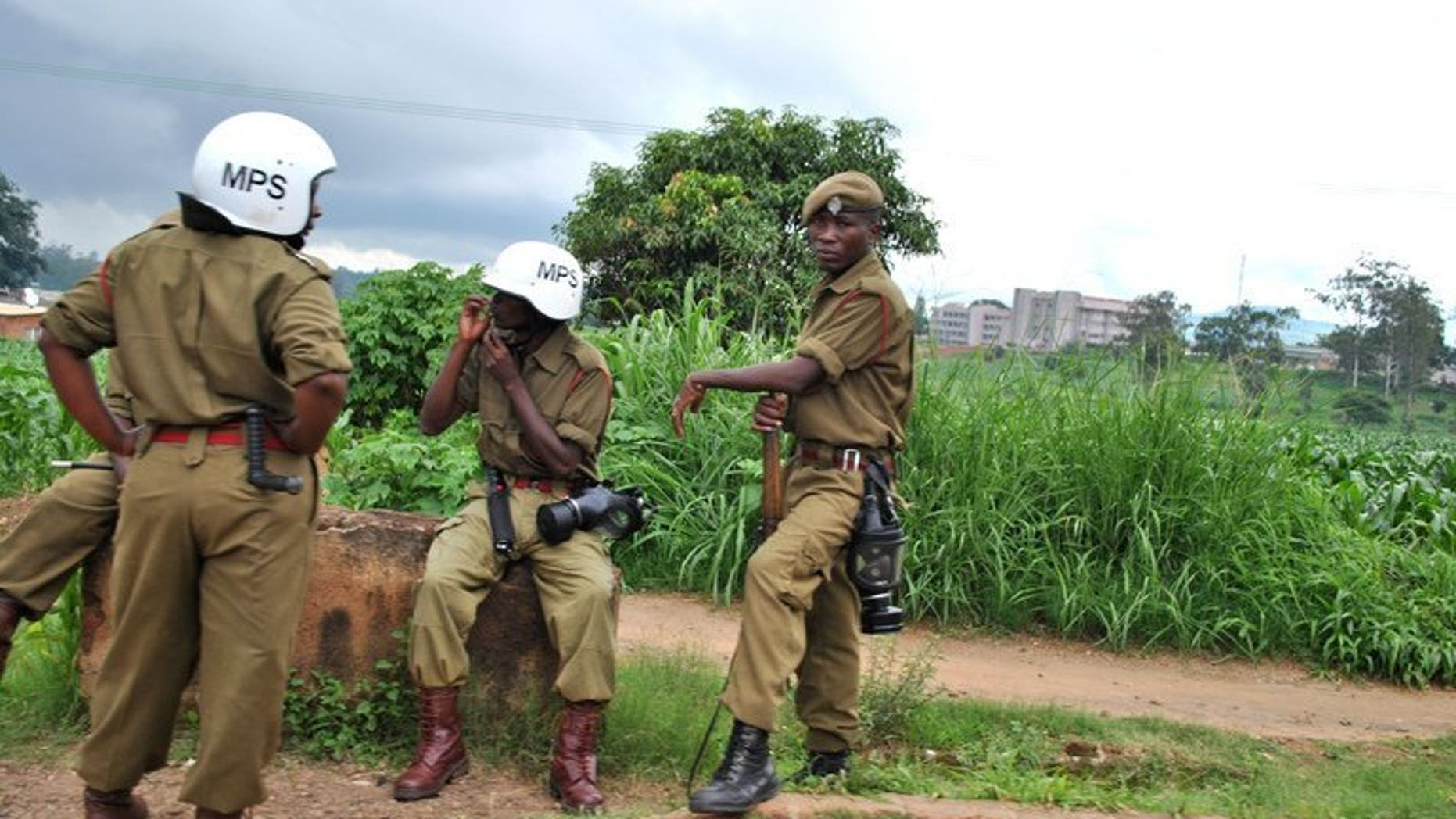 """Police officers in combat gear sot near the flea market in the Malawi capital Blantyre on January 17, 2013. Police in Malawi said Tuesday they had arrested a 37-year-old man and charged him with breaching the peace, after he allegedly called President Joyce Banda """"stupid."""""""