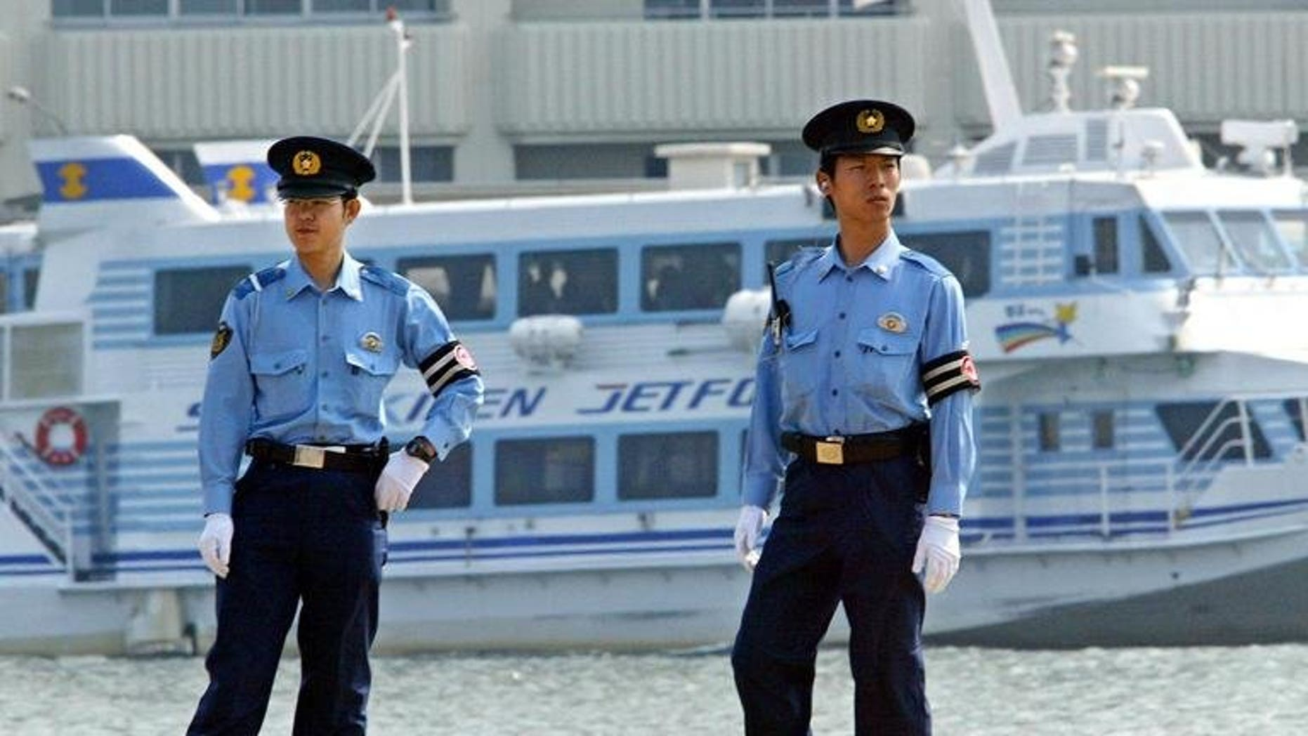 "Japanese policemen patrol the Niigata Port, on June 8, 2003. Police on Friday arrested a man who left a ""haiku"" poem when he disappeared after five people were murdered in a tiny mountain village."