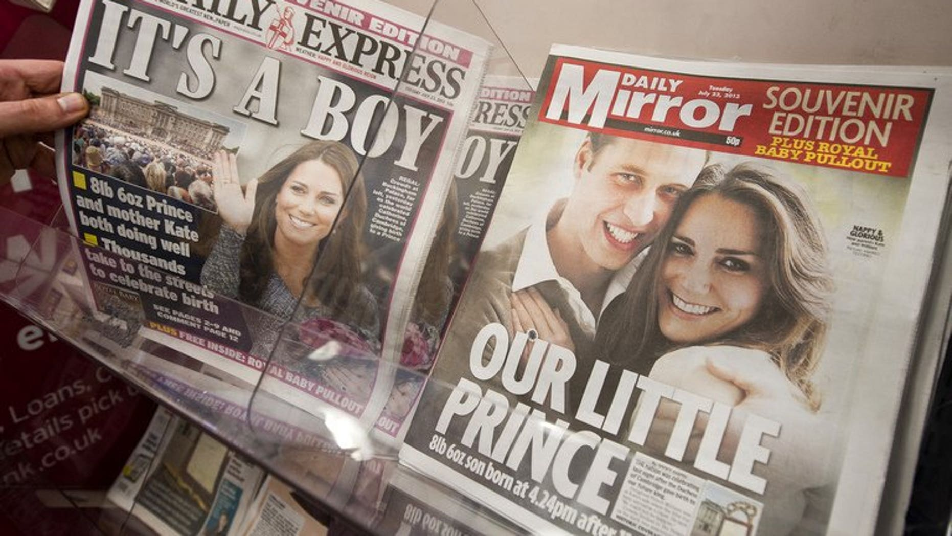 Newspaper front pages report news of the birth of a new royal baby in London on July 23, 2013.