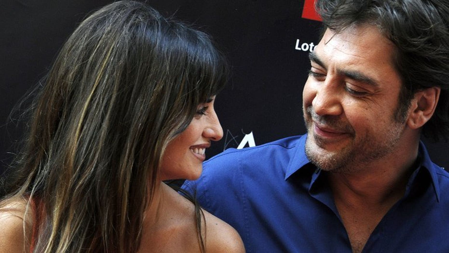 Spanish actress Penelope Cruz talks with her husband, Spanish actor Javier Bardem in Madrid on June 27, 2011. The Oscar-winning Spanish film stars had their second child--a girl according to Spanish media reports.