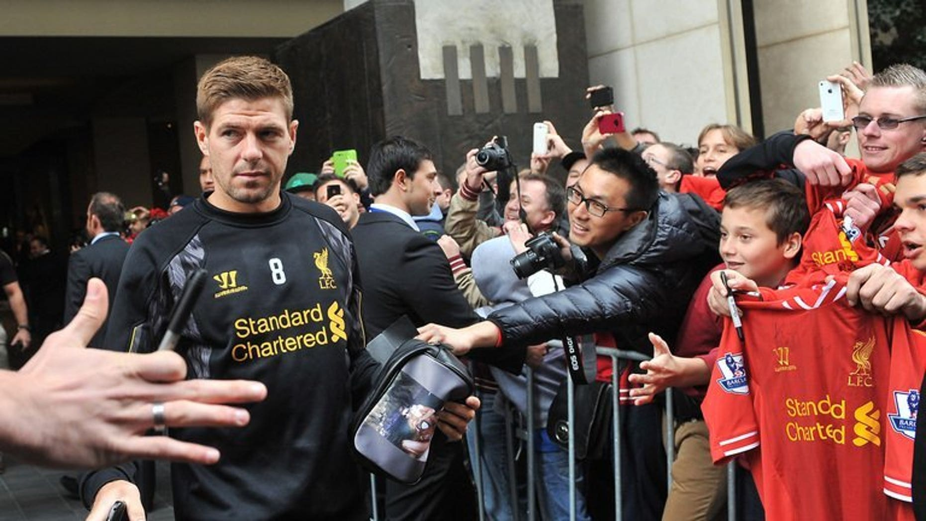 Liverpool midfielder Steven Gerrard acknowledges fans as the team leaves their hotel for a training session in Melbourne on July 22, 2013. Gerrard said Wednesday he believes success is just around the corner for the Merseyside club, and urged the team's owners to keep backing manager Brendan Rodgers.