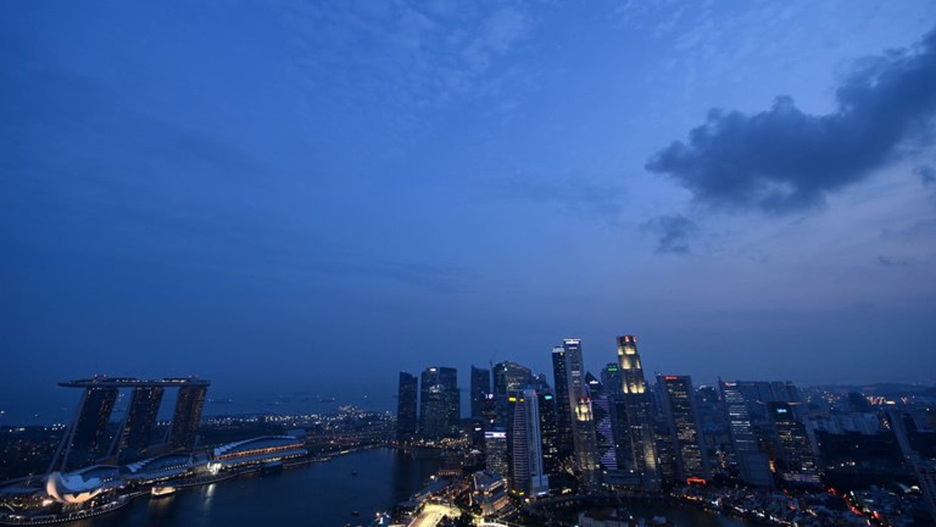 The sun sets over the Singapore skyline on September 17, 2012. A Singapore court on Wednesday charged a senior anti-corruption official with siphoning off more than a million dollars of government money to fund his casino gambling habit.