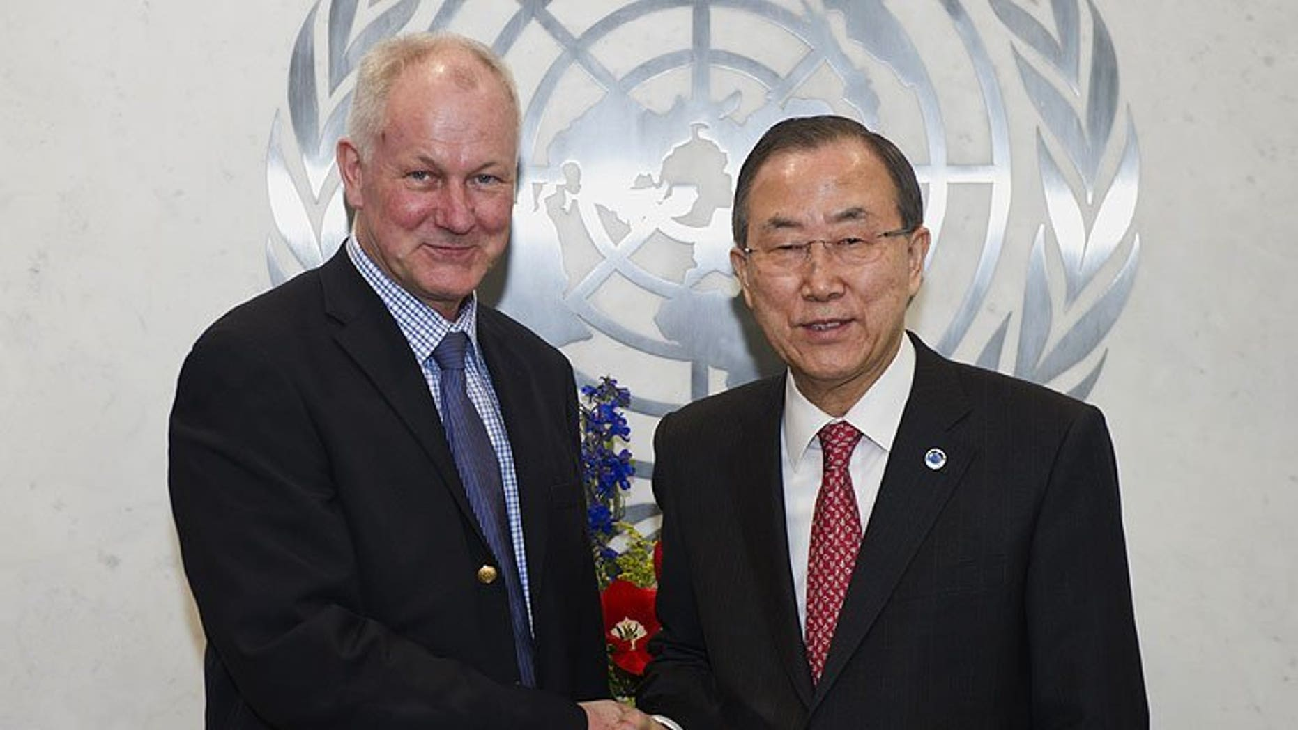 United Nations Secretary General Ban Ki-Moon (right) shakes hands with Swedish scientist Ake Sellstrom -- the head of the UN chemical weapons investigation team -- before their meeting at the UN headquarters in New York, on April 29, 2013. UN inspectors Sellstrom and Angela Kane -- tasked with examining claims that chemical weapons were used in Syria's civil war -- have arrived in Damascus.