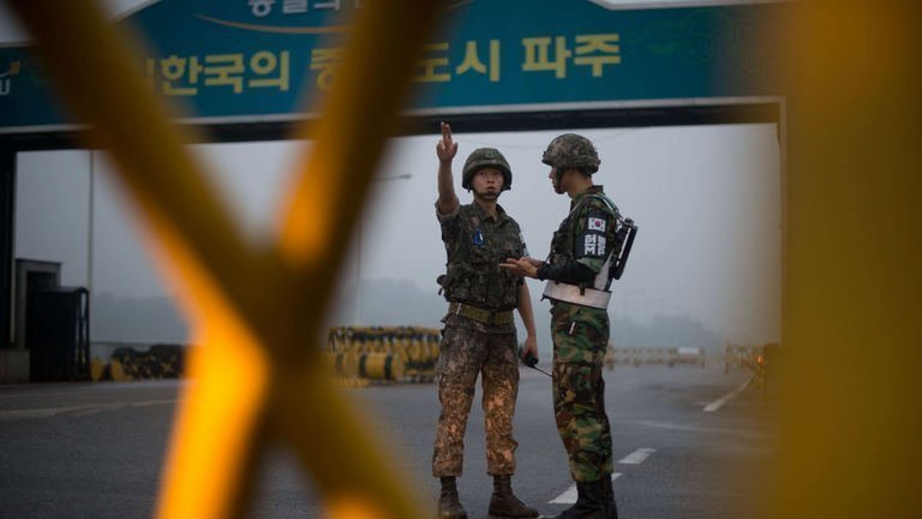 South Korean soldiers stand at a military checkpoint leading to the Kaesong joint industrial complex in North Korea on July 10, 2013. North and South Korea will hold fresh talks Thursday on reopening a joint industrial zone amid growing concern that the last symbol of peace between the two countries might be heading for a permanent closure.