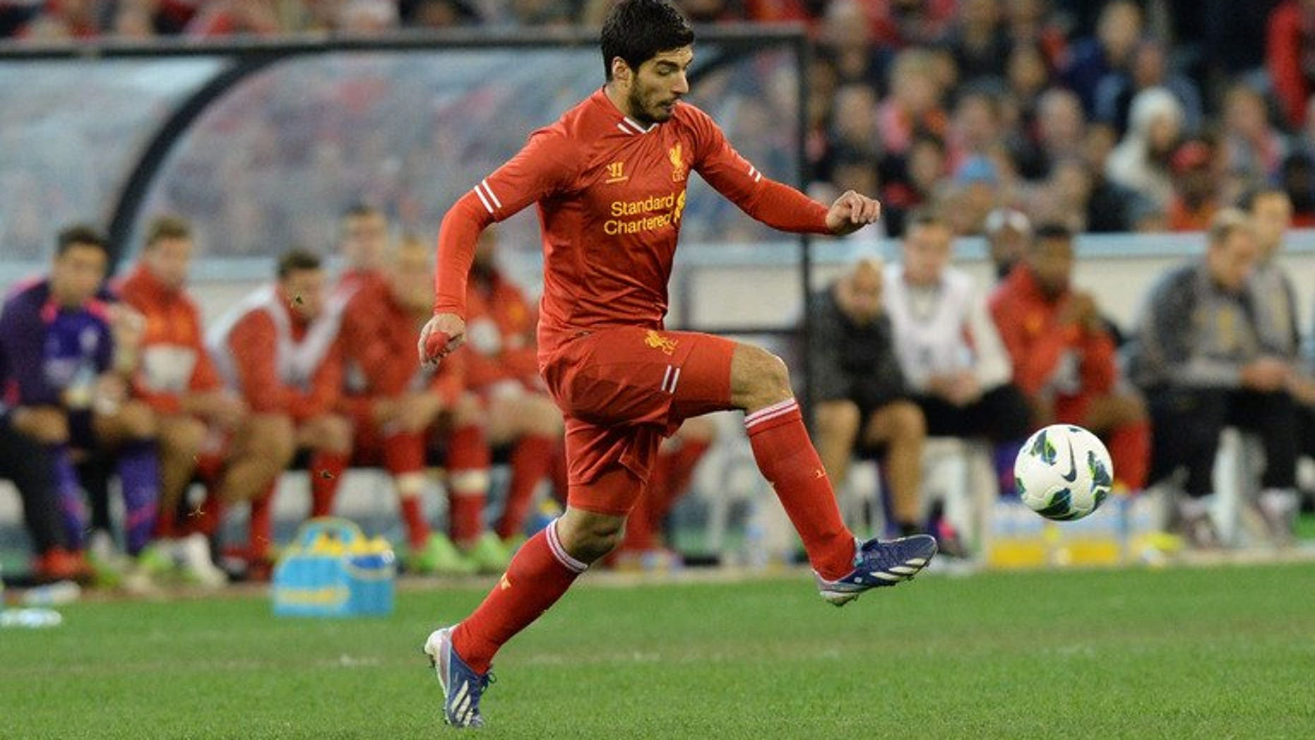 Liverpool's Luis Suarez controls the ball against the Melbourne Victory during their football friendly match at the MCG in Melbourne on July 24, 2013. Manager Brendan Rodgers has urged Suarez to repay the faith placed in him by supporters after Liverpool's emotional 2-0 win on their pre-season tour in Australia.