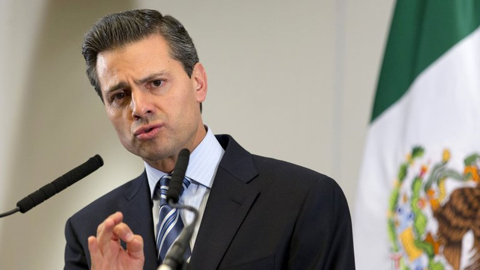 "Mexican President Enrique Pena Nieto, pictured during a press conference in London on June 18, 2013, will be operated on next week to have a benign ""thyroid nodule"" removed, his office said."