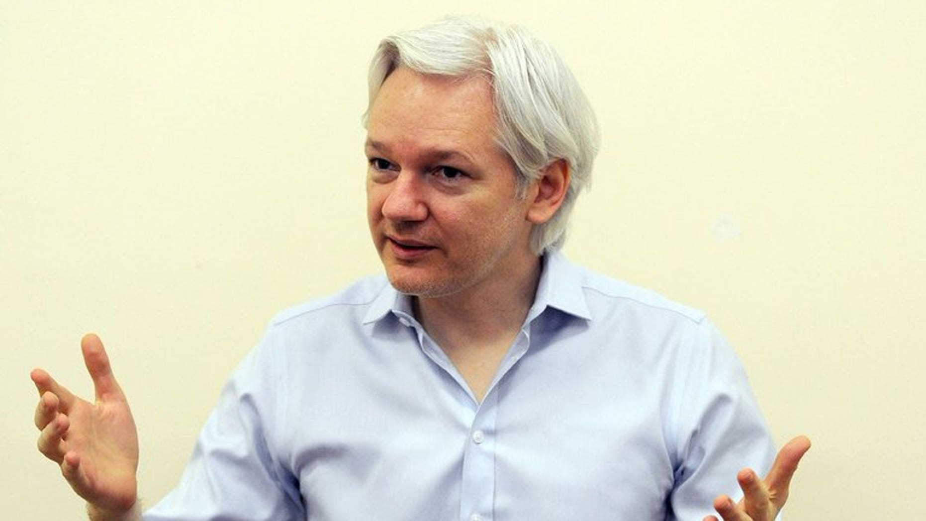 """Wikileaks founder Julian Assange speaks to the media inside the Ecuadorian Embassy in London on June 14, 2013. Assange Thursday officially launched his political party to contest Australian elections this year, saying a victory for this candidates would be akin to planting the country's """"best investigative journalists"""" in the Senate."""