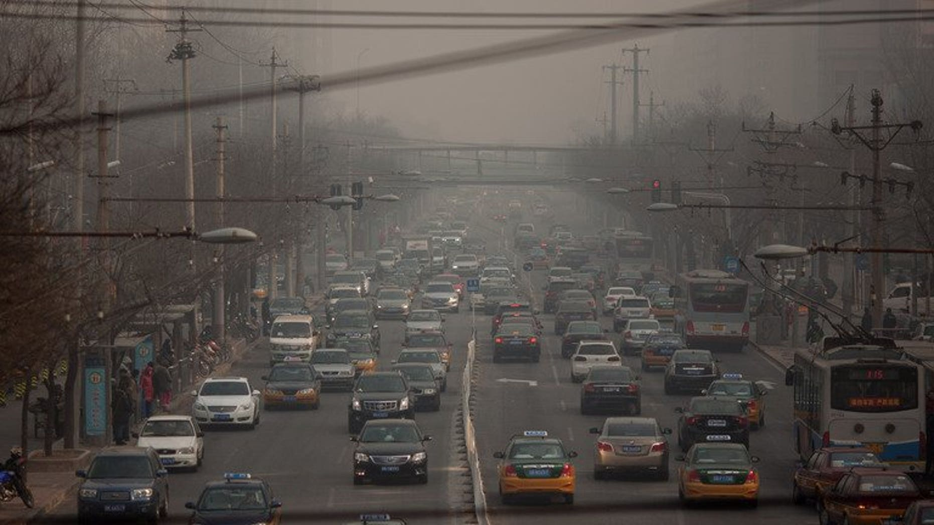 Traffic makes its way through Beijing on January 12, 2013. A Chinese man threw a two-year-old girl to the ground, killing her, after her mother apparently refused to make way for him to park his car, state media reported Thursday.