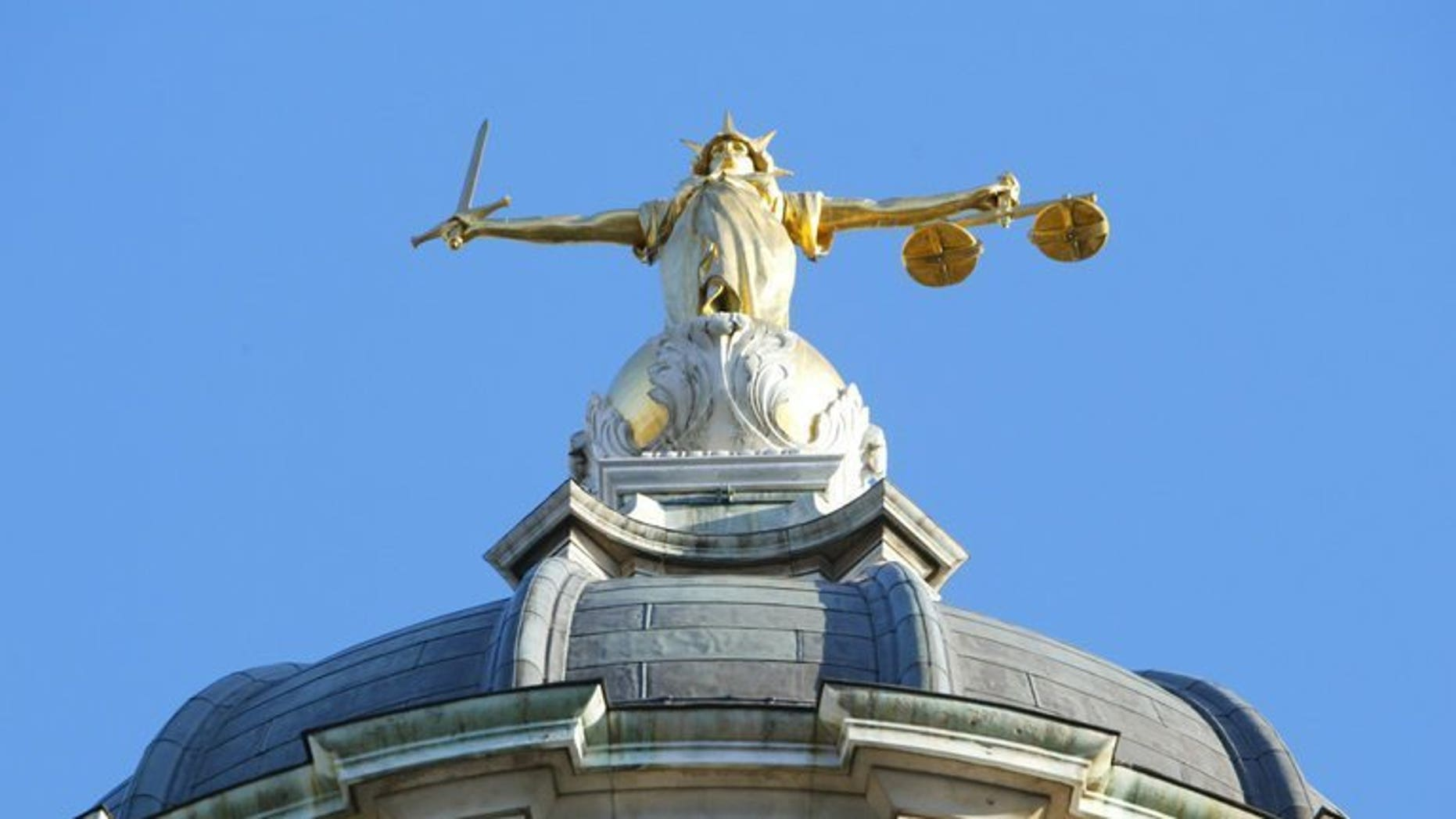 """The statue of justice, on the roof of the Old Bailey, pictured on December 17, 2003 in London. A Ukrainian man charged over three mosque bombings in the West Midlands and the """"terrorist-related"""" murder of an elderly Muslim man is due to appear in court later."""