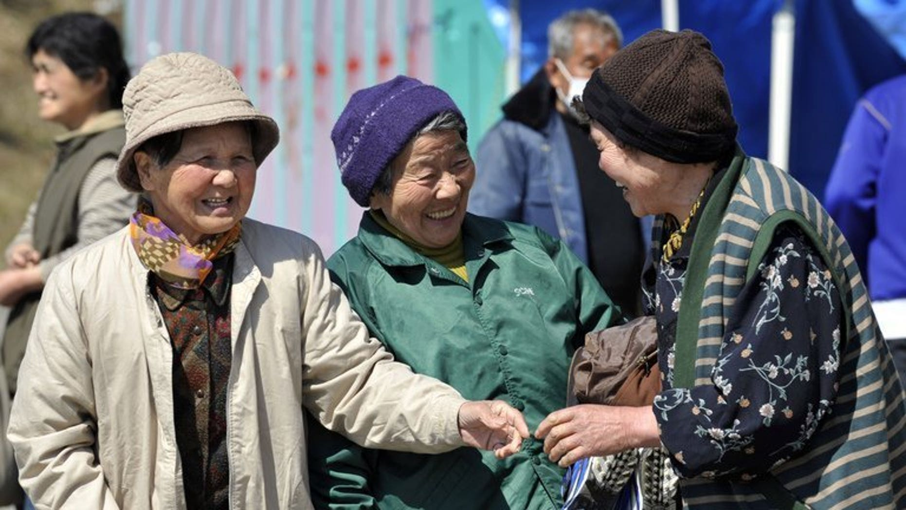 Elderly women are seen chatting in the town of Minamisanriku in Miyagi prefecture on April 5, 2011. Japan's women retook their place as the world's longest-lived last year, edging out Hong Kongers as their life expectancy bounced back from the dip caused by the 2011 tsunami, officials said.