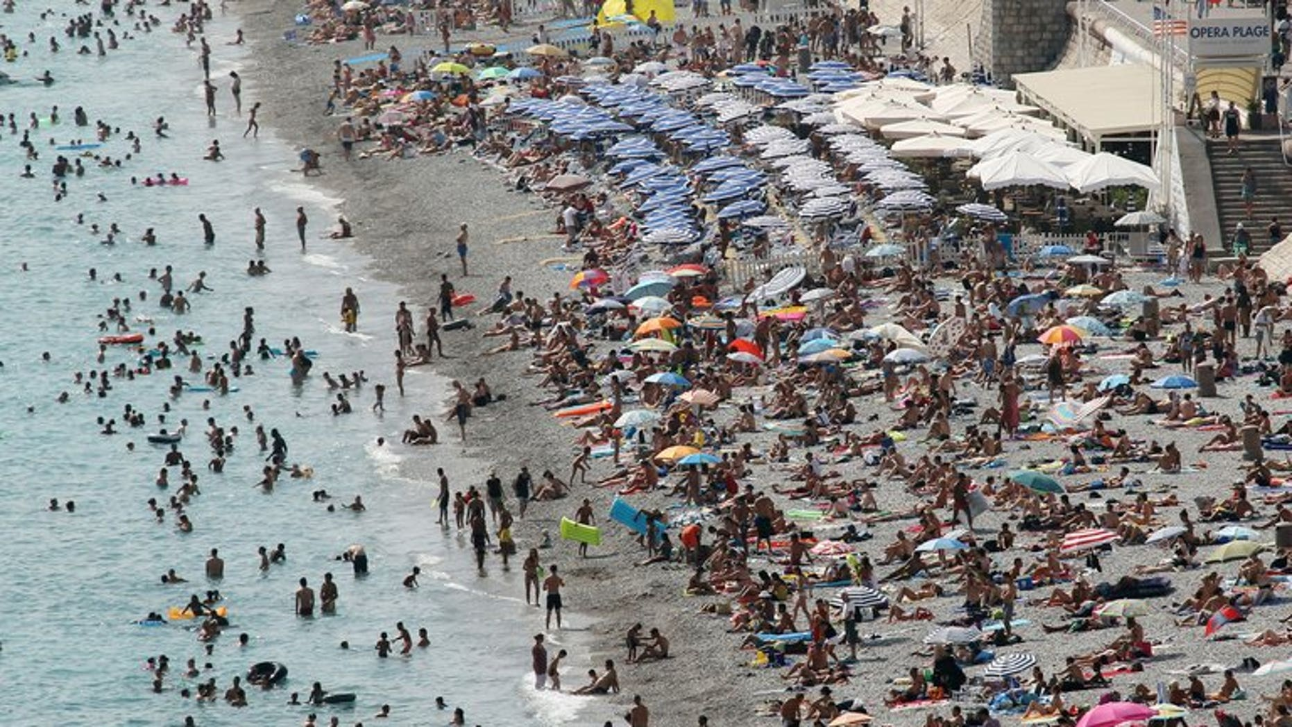 A picture taken on August 22, 2012 shows the beach in Nice, southeastern France. A 16-year-old British boy has disappeared while swimming off the southwestern coast of France and is unlikely to be found alive, maritime officials say.