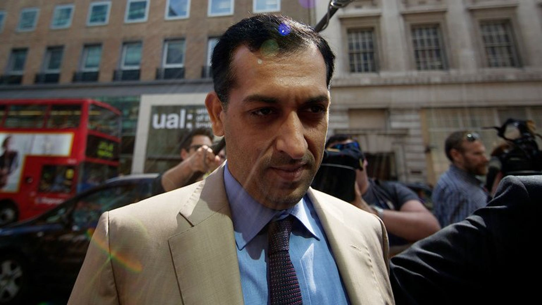 Godolphin trainer Mahmood al-Zarooni arrives for a disciplinary hearing at the British Horseracing Authority (BHA) in London on April 25, 2013. Godolphin are to face no further charges in relation to a doping scandal that saw one of the stable's leading trainers banned from racing for eight years, the British Horseracing Authority said.