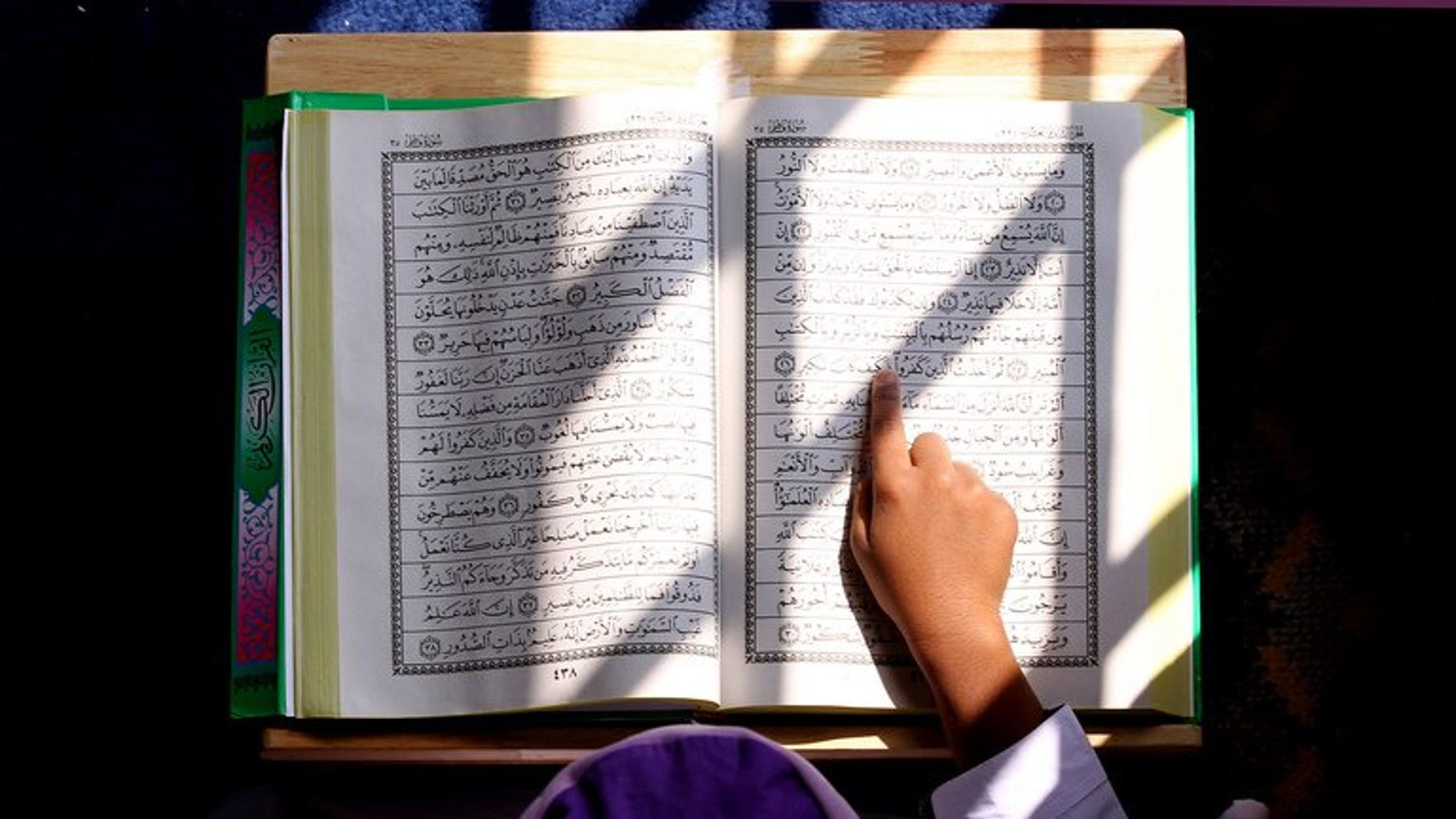 A Malaysian Muslim boy reads from the Koran inside a mosque in Kuala Lumpur on July 31, 2011. A Malaysian court on Thursday ruled against the 2009 conversion of three Hindu children to Islam without their mother's knowledge, a verdict welcomed by non-Muslim groups.