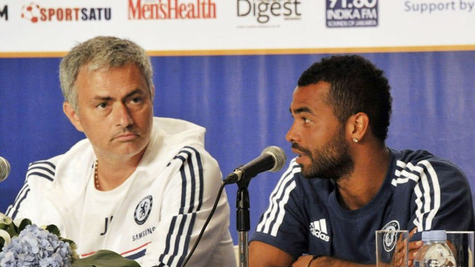 Chelsea football club manager Jose Mourinho (L) listens as player Ashley Cole (R) speaks during a press conference at a hotel in Jakarta on July 23, 2013. Chelsea turned on the style in an 8-1 rout of Indonesia All-Stars Thursday as they completed their Asian tour with a 100 percent record under returning manager Mourinho.