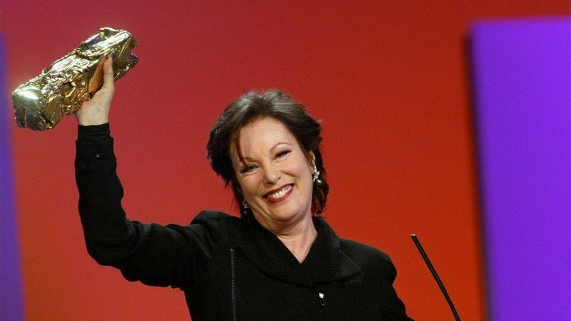 French actress Bernadette Lafont smiles as she receives the Honorary Cesar during the 28th Cesar Awards ceremony in Paris, February 22, 2003. Lafont died on July 25, 2013 in Nimes, southern France.