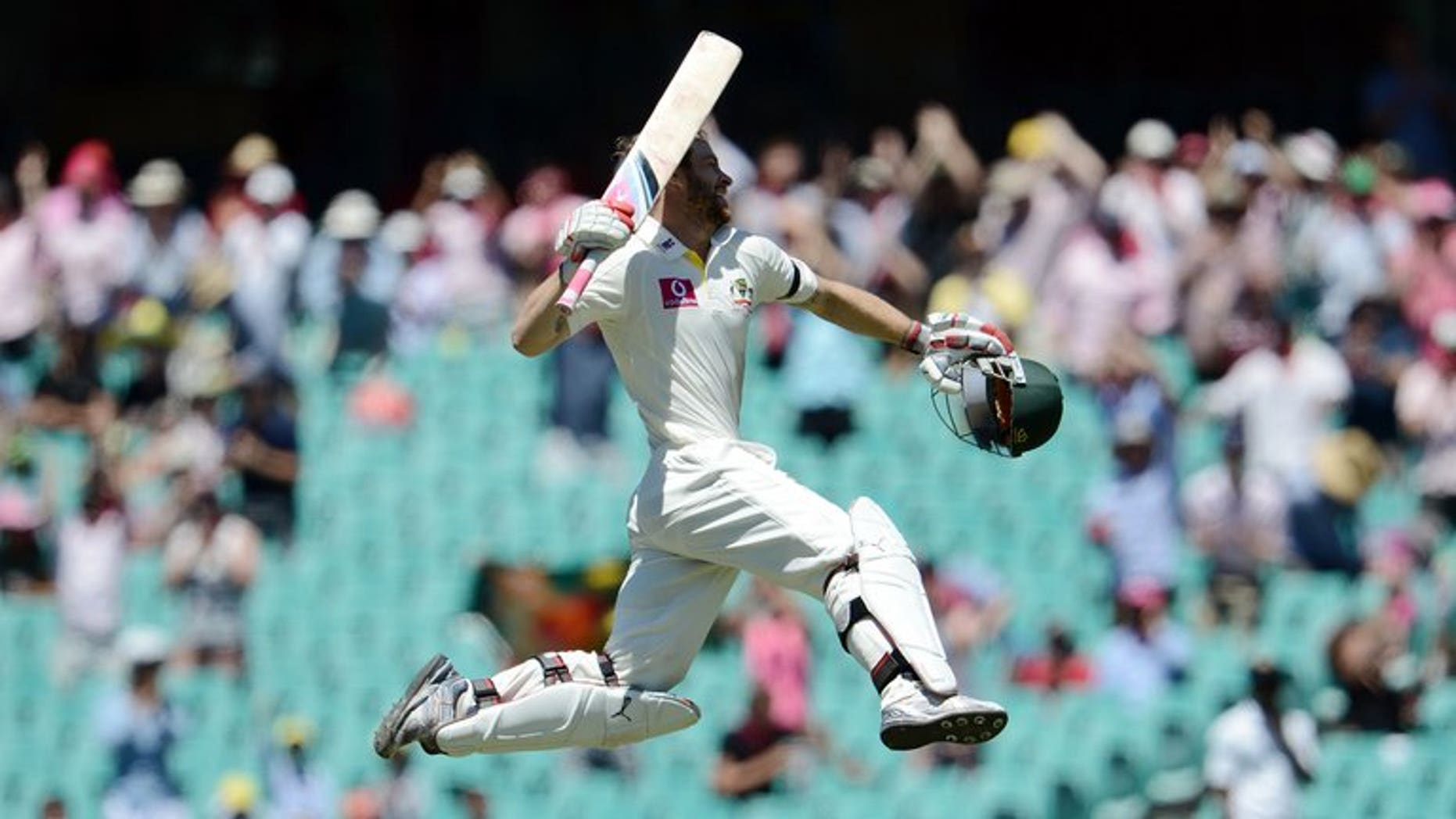 Australian batsman Matthew Wade celebrates after scoring a century at the Sydney Cricket Ground on January 5, 2013. Wade has no problems about giving up his wicketkeeping role if he can earn a place in Australia's Ashes side as a specialist batsman.