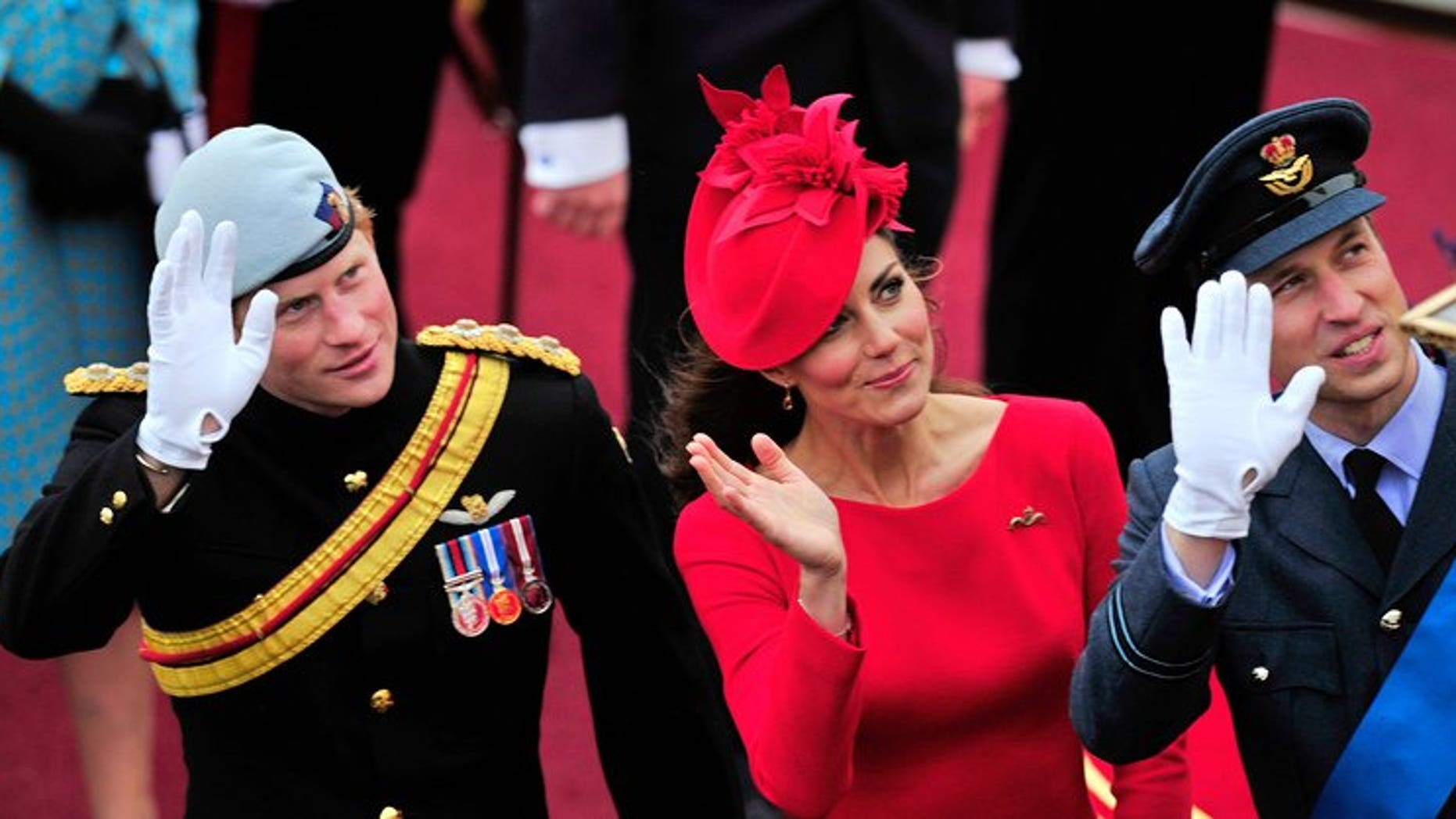 """Britain's Catherine, Duchess of Cambridge, (C) Prince William (R) and Prince Harry (L) wave as they pass the Houses of Parliament in central London, on June 3, 2012. Prince Harry on Thursday promised to use his expertise to make sure his new nephew George """"has fun""""."""