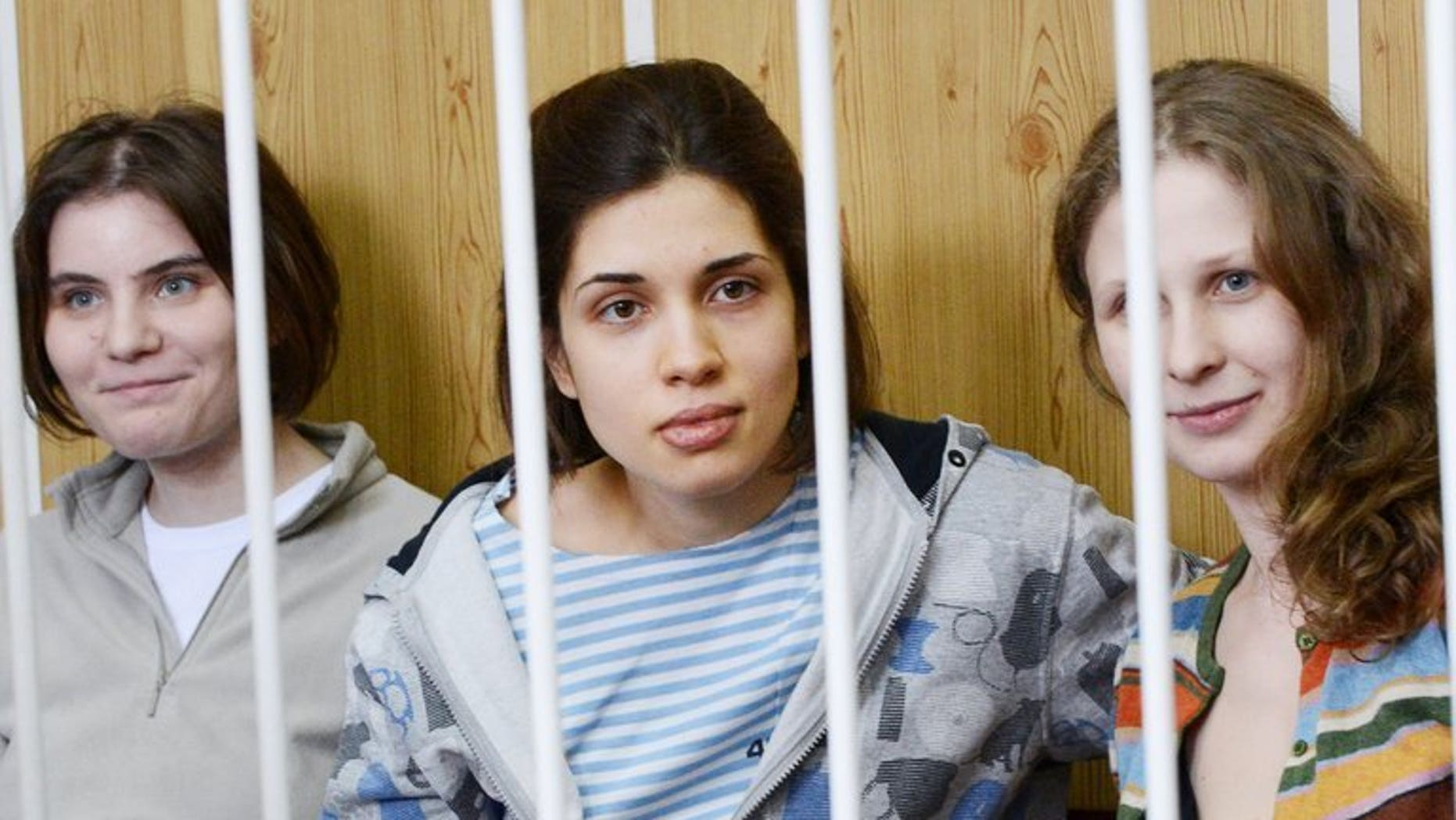 Picture taken on July 20, 2012 shows members of the all-girl punk band Pussy Riot Nadezhda Tolokonnikova (C), Maria Alyokhina (R) and Yekaterina Samutsevich during a court hearing in Moscow. A Russian court on Friday ruled to keep Tolokonnikova in prison, after she appealed an earlier decision denying her release on parole from her sentence over a church protest against President Vladimir Putin.