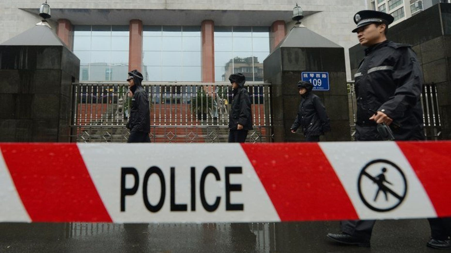 File image shows a policemen on guard outside the Chengdu People's Intermediate court in Chengdu, southwest China's Sichuan province, on September 24, 2012. A knife-wielding Chinese man has stabbed five people to death and wounded another three in the central Henan province, state media reported Friday.
