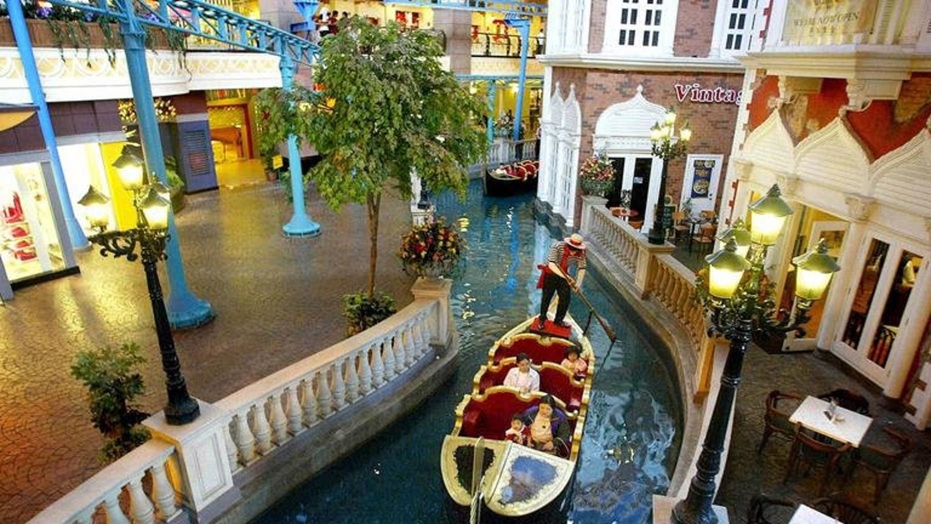 A Venician gondola carries visitors in a mini river at the new First World Plaza in Genting Highlands, north of Kuala Lumpur, on July 27, 2002. Malaysian casino operator Genting's resort unit will build a 400 million ringgit ($125 million) Twentieth Century Fox Theme Park near the capital Kuala Lumpur.