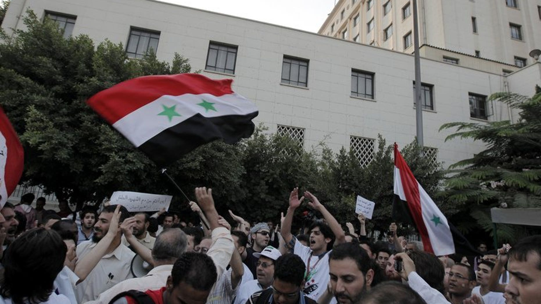 Syrians living in Egypt protest against President Bashar al-Assad in Cairo on October 16, 2011. Rising anti-Syrian rhetoric and arbitrary arrests are pushing a growing number of Syrian war exiles in Egypt to seek UN protection, the world body's refugee agency said Friday.
