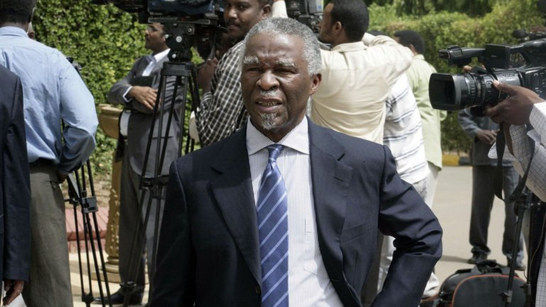 South Africa's former president Thabo Mbeki walks past journalists as he leaves after a meeting with Sudanese president on July 25, 2013 in the Sudanese capital, Khartoum. He was part of securing a deal for Sudan to delay closing an economically vital pipeline carrying South Sudanese oil.