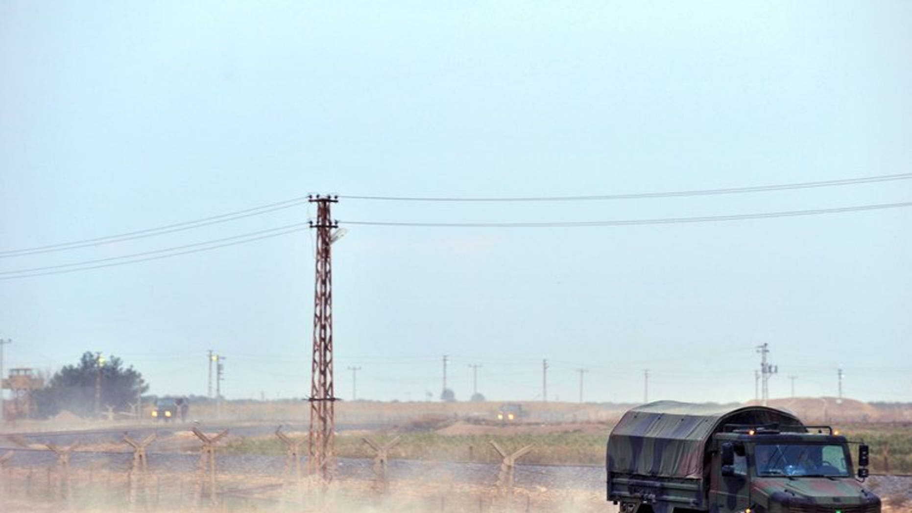 Turkish soldiers patrol on the Turkish-Syrian border near the town of Ceylanpinar on November 11, 2012. A man was killed and his three children wounded Friday in southeastern Turkey by a mortar shell fired from across the border with conflict-torn Syria, a newspaper reported.