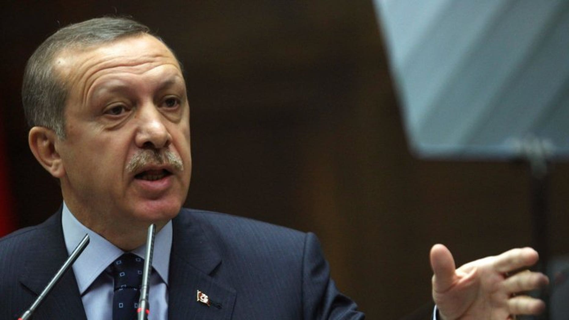 Turkey's Prime Minister Recep Tayyip Erdogan holds a meeting at the Turkish parliament in Ankara on May 14, 2013. Erdogan warned against any plans for an autonomous Kurdish region in northern Syria as officials met the leader of the war-torn country's main Kurdish group Friday.