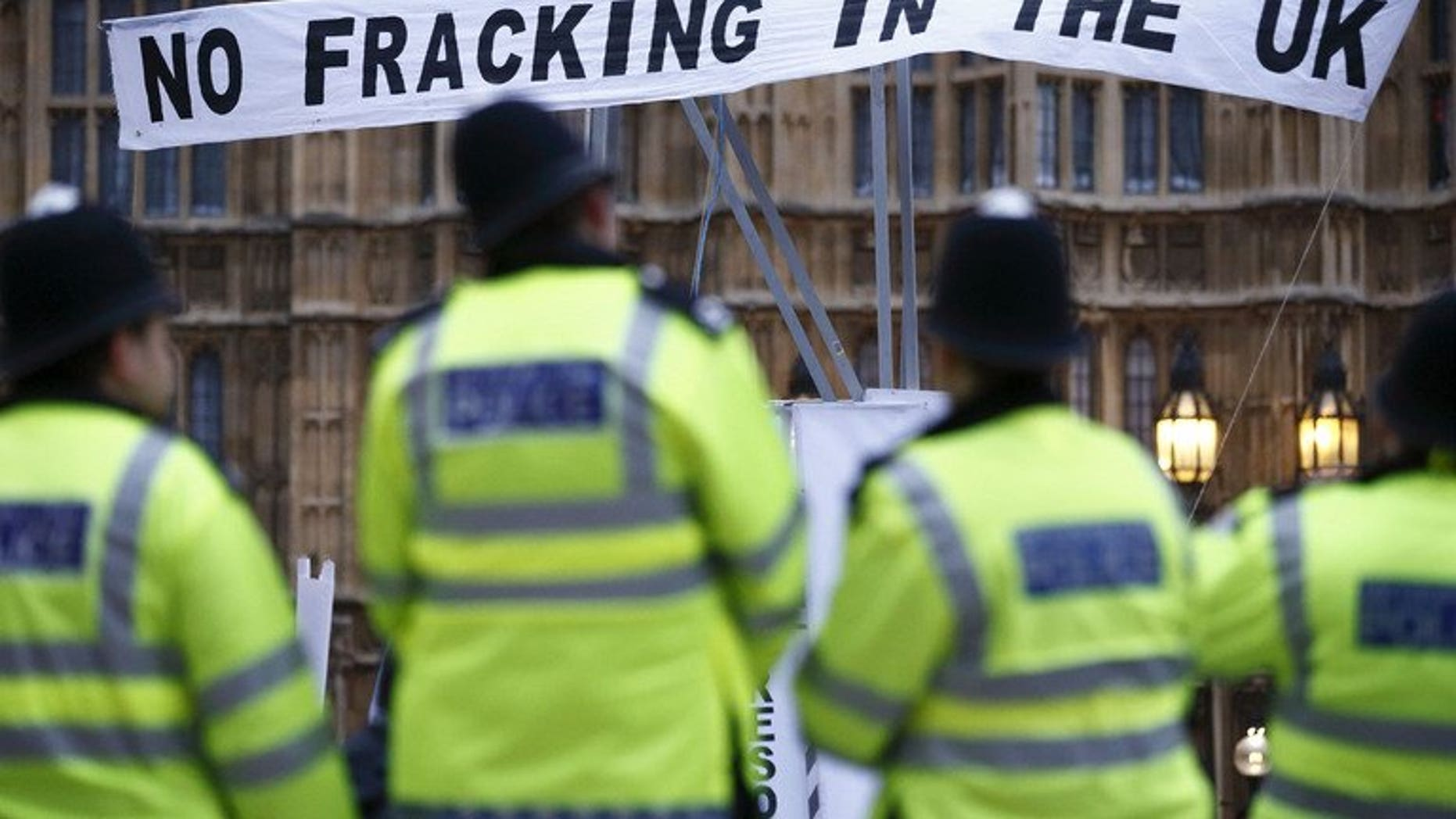 British police secure the area near protesters against fracking in London on December 1, 2012. Sixteen protesters were arrested as police broke up a blockade against exploratory drilling by a fracking company in southern England.