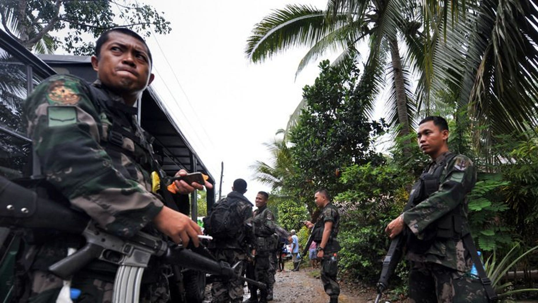 This file photo shows members of a police special action force manning a checkpoint on the southern Philippine island of Mindanao, on December 12, 2009. Six people were killed and more than two dozen wounded when a bomb exploded at a restaurant in a town on Mindanao late on Friday, July 26, 2013.