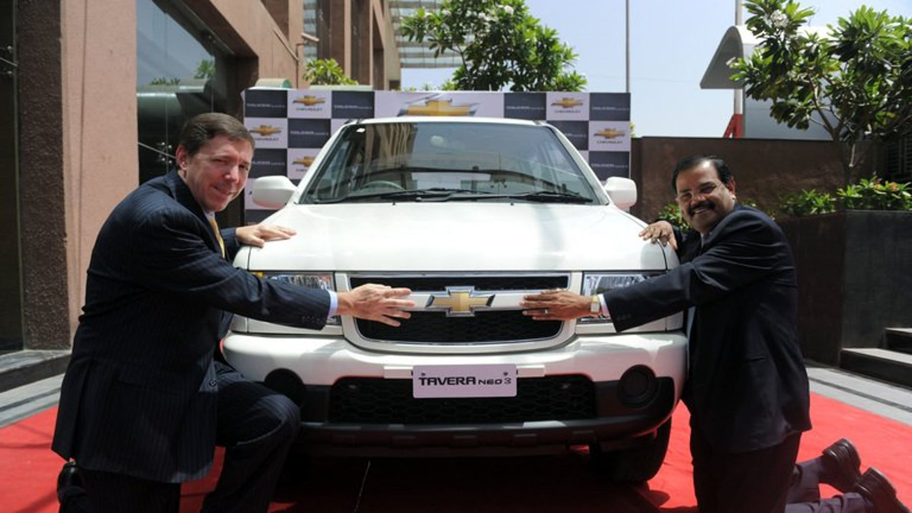 """General Motors India's president and managing director Lowell Paddock (left) and vice president of corporate affairs GM India P Balendran in Ahmedabad on March 23, 2012. GM said Saturday it has fired """"several employees"""" after violations of company policy led to the recall of 114,000 of its Chevrolet Tavera sport-utility vehicles in India."""