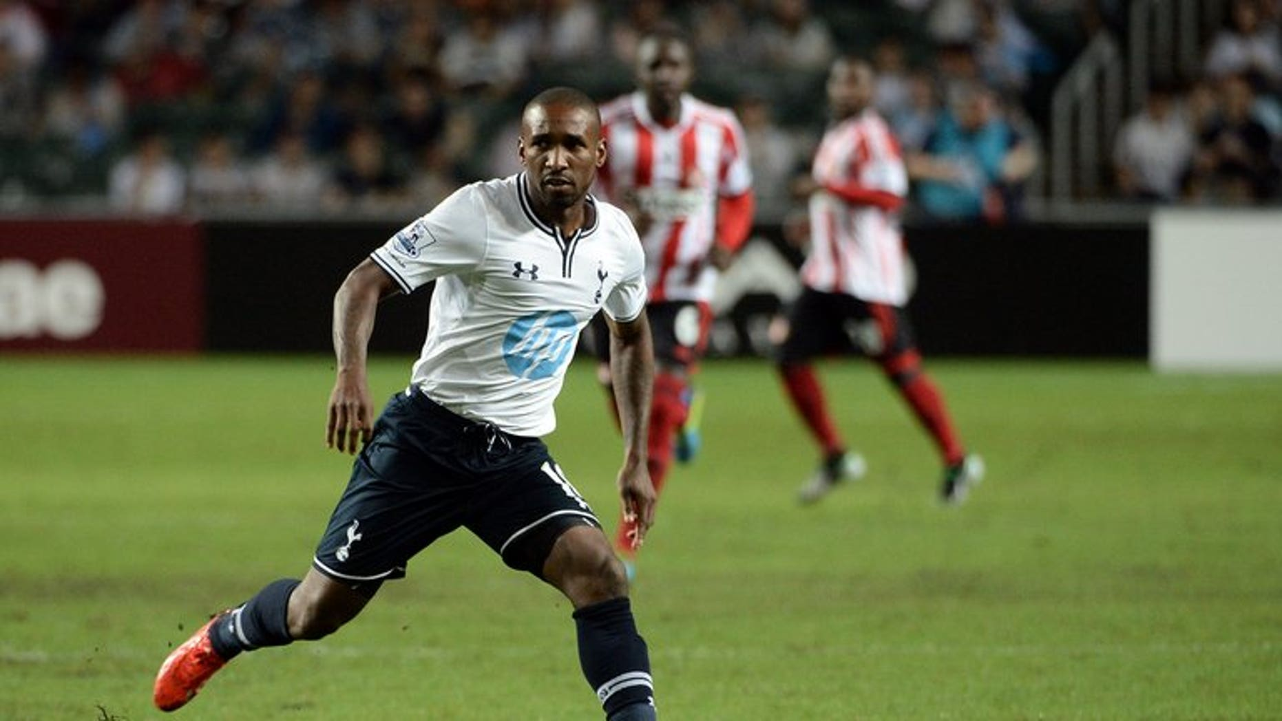 Jermain Defoe of Tottenham Hotspur controls the ball against Sunderland during their football match in the Barclays Asia Trophy tournament at Hong Kong Stadium on July 24, 2013. Spurs eased to a 6-0 romp over a hopelessly outclassed South China on Saturday in Hong Kong with Defoe scoring a hat-trick and setting up another successful strike.