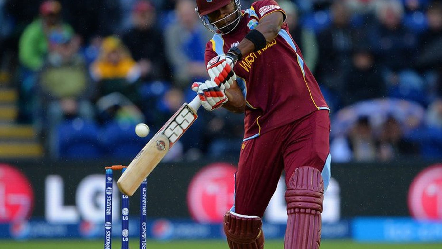 West Indies' Kieron Pollard bats on June 14, 2013. Late hitting by him and captain Darren Sammy lifted the West Indies to a competitive 152 for seven against Pakistan in the first Twenty20 international at the Arnos Vale Stadium.