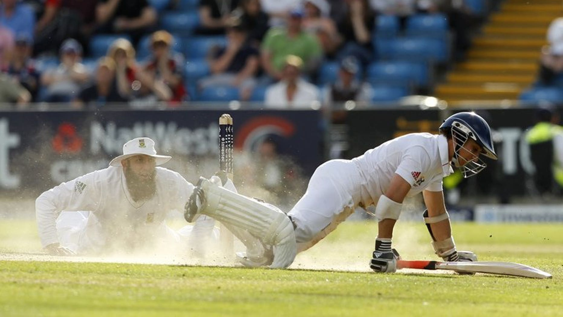 England's James Taylor (R) dives to avoid a run on August 4, 2012. He advanced his case for an England recall by making an unbeaten 64 for Sussex against Australia on the second day of three at Hove.