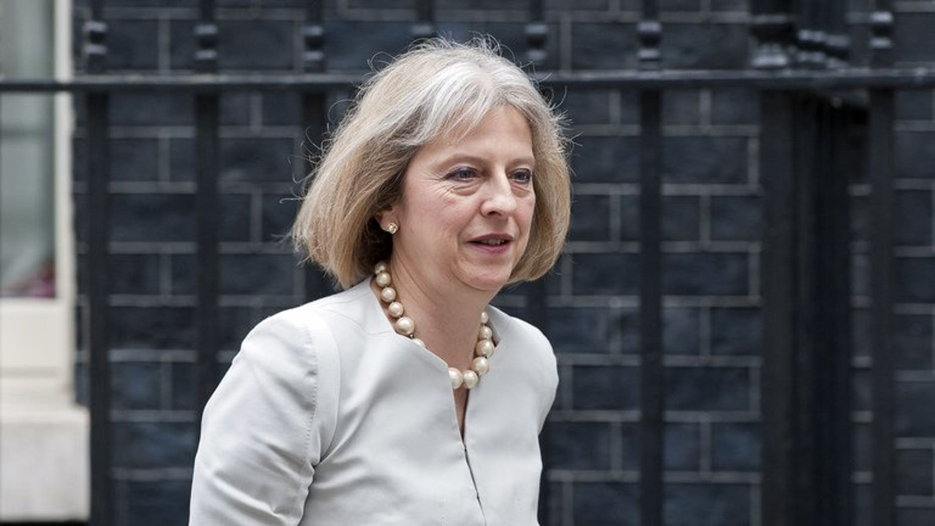 Home Secretary Theresa May leaves 10 Downing Street on June 26, 2013, after attending a cabinet meeting. May has been diagnosed with type 1 diabetes, a serious form of the condition that means she will need daily insulin injections for the rest of her life.