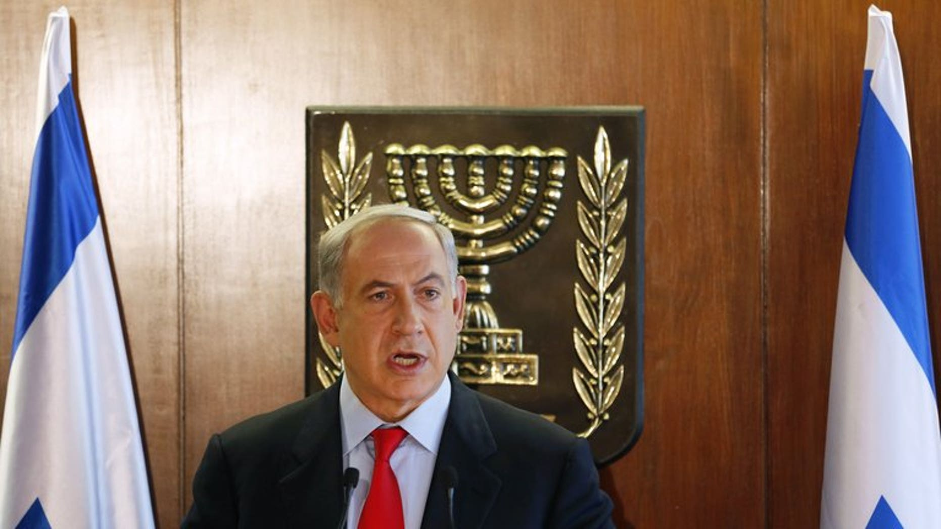 Israel's Prime Minister Benjamin Netanyahu delivers a statement to the media, in Jerusalem, on July 22, 2013. He will seek cabinet approval on Sunday for a contentious release of 104 veteran Palestinian and Israeli-Arab prisoners, to coincide with the resumption of peace talks.