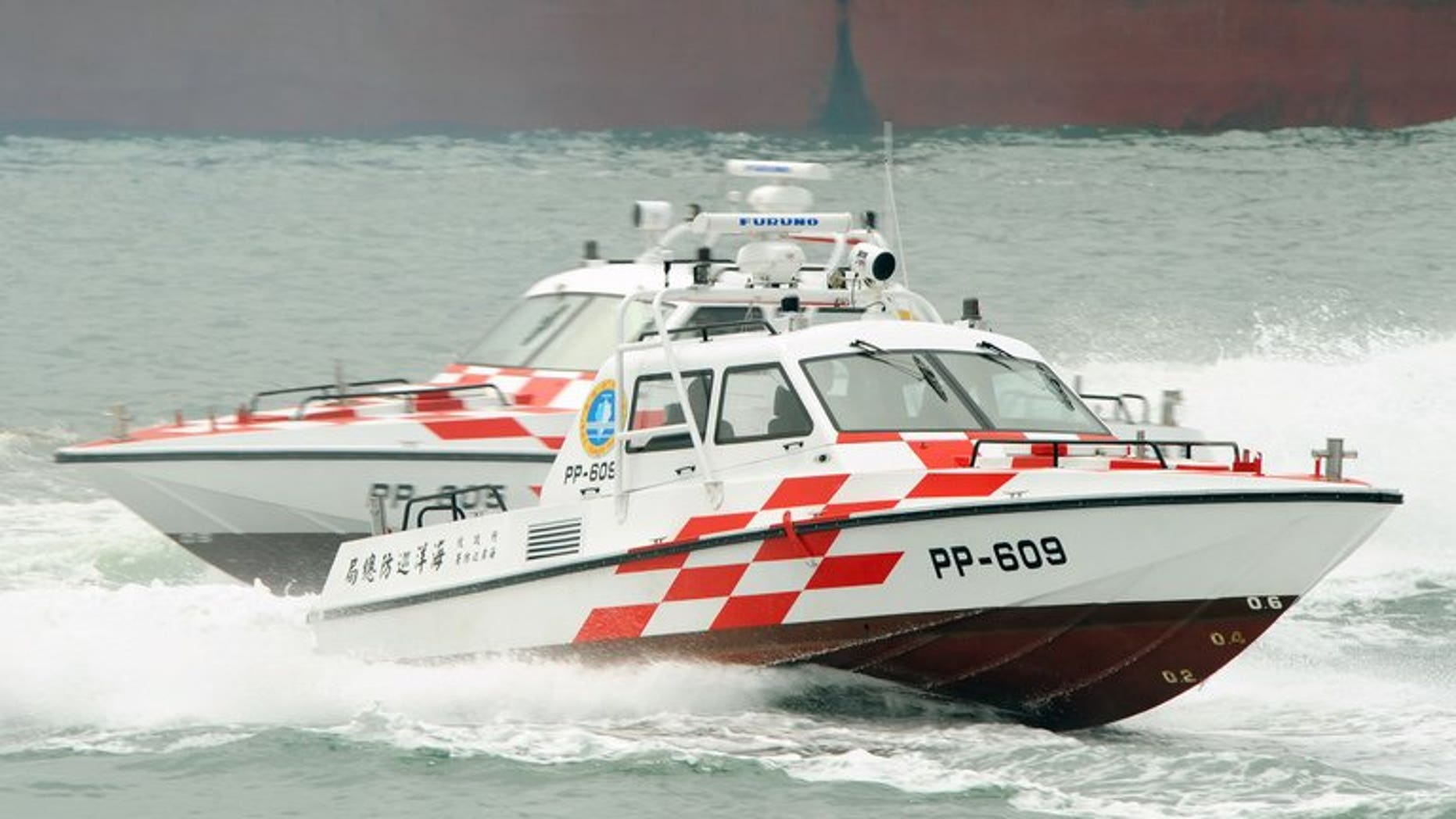In this file photo, Taiwan coastguard's speed-boats demonstrate their combat skills during a drill near New Taipei City, on June 29, 2011. The coastguard on Saturday raided a fishing vessel thousands of miles offshore, arresting nine Indonesian crew suspected of murdering their Taiwanese captain and chief engineer, according to officials.